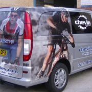 76-3-2139-half-vehicle-wrap-using-digitally-printed-cast-vinyl-overlaminate-and-contravision